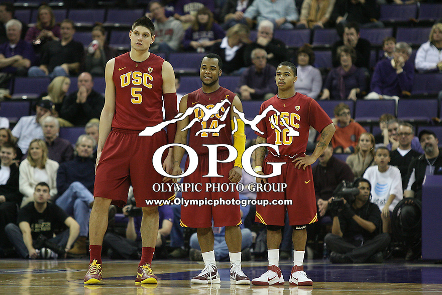Mar 05, 2011:  USC's #5 Nikola Vucevic, #14 Donte Smith and #10 Maurice Jones watch from center court against Washington.  USC defeated Washington 62-60 at Alaska Airlines Arena Seattle, Washington...
