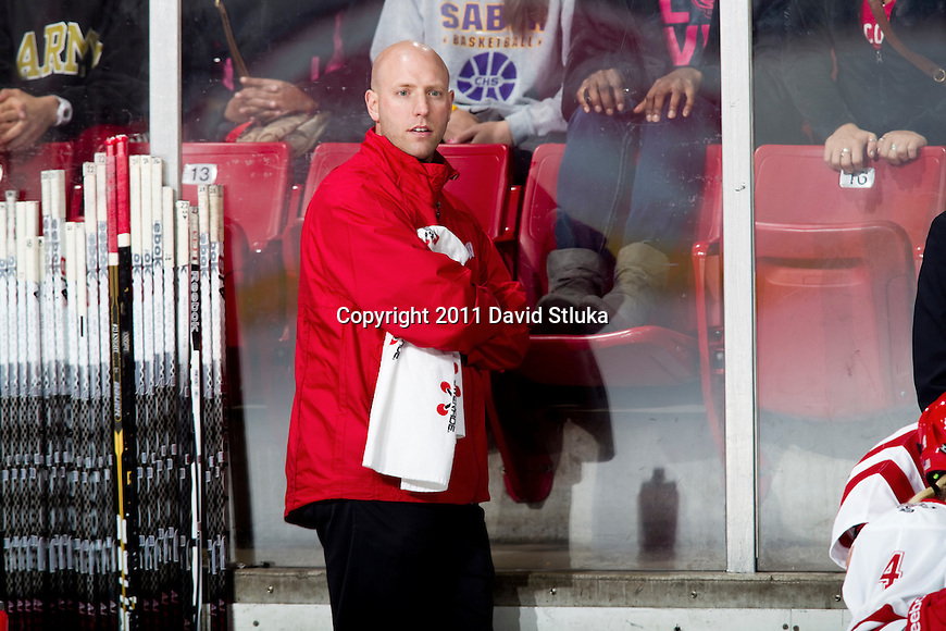 Wisconsin Badgers Director of Women's Hockey Operations Paul Hickman looks on during an NCAA women's hockey game against the Minnesota Golden Gophers on October 14, 2011 in Madison, Wisconsin. The Badgers won 3-2. (Photo by David Stluka)