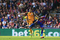 Shane Duffy of Brighton & Hove Albion tangles in the air with Wilfred Zaha of Crystal Palace during Crystal Palace vs Brighton & Hove Albion, Premier League Football at Selhurst Park on 14th April 2018