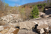 The abandoned Redstone Granite quarry in Conway, New Hampshire. The Redstone Granite Quarry is an abandoned quarry at the base of Rattlesnake Mountain in Redstone (part of the town of Conway). Piles of granite can be seen on the left.