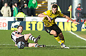 CELTIC'S JOE LEDLEY GETS PAST ST MIRREN'S DAVID VAN ZANTEN