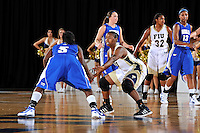 12 January 2012:  FIU guard Kamika Idom (14) defends Middle Tennessee State guard Shanice Cason (5) in the second half as the Middle Tennessee State University Blue Raiders defeated the FIU Golden Panthers, 74-60, at the U.S. Century Bank Arena in Miami, Florida.