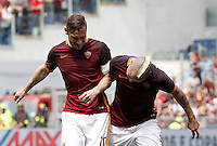 Calcio, Serie A: Roma vs ChievoVerona. Roma, stadio Olimpico, 8 maggio 2016.<br /> Roma's Francesco Totti, left, and Radja Nainggolan celebrate after their teammate Miralem Pjanic scored during the Italian Serie A football match between Roma and ChievoVerona at Rome's Olympic stadium, 8 May 2016.<br /> UPDATE IMAGES PRESS/Isabella Bonotto