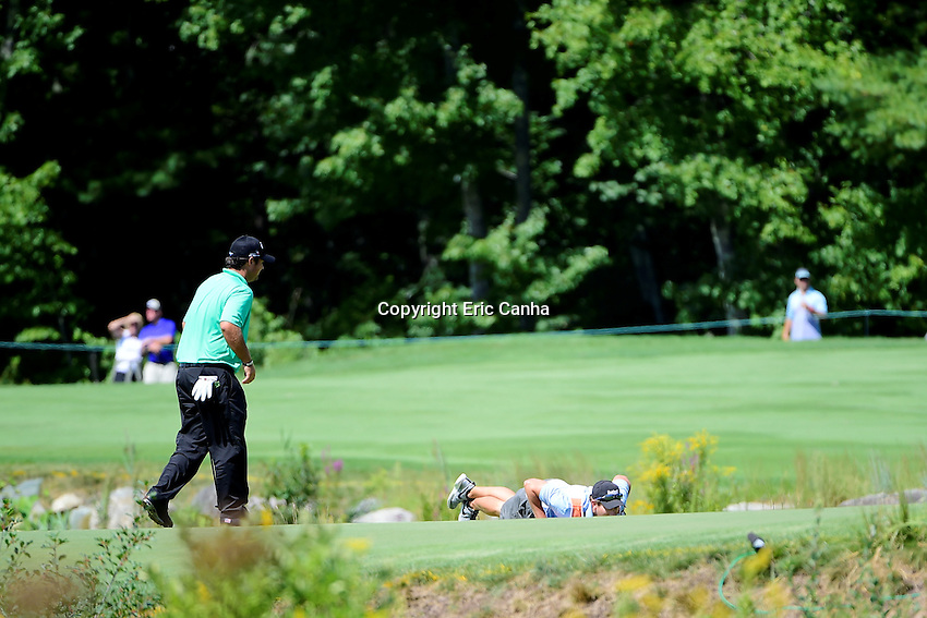 Friday, September 2, 2016:  Patrick Reed's caddy Kessler Karain lays on the green to read a putt during the first round of the Deutsche Bank Championship tournament held at the Tournament Players Club, in Norton, Massachusetts.  Eric Canha/Cal Sport Media