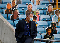 14th July 2020; The Den, Bermondsey, London, England; English Championship Football, Millwall Football Club versus Blackburn Rovers; Blackburn Rovers manager Tony Mowbray observing the Millwall players during pre match training before kick off from the away players tunnel