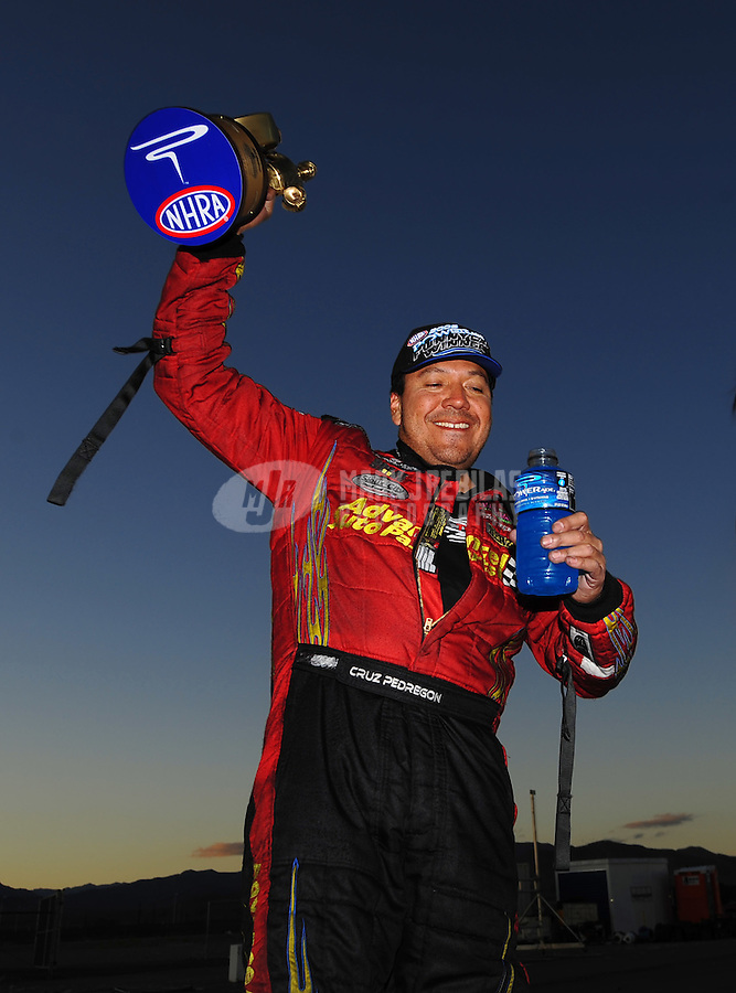 Nov. 2, 2008; Las Vegas, NV, USA: NHRA funny car driver Cruz Pedregon after winning the Las Vegas Nationals at The Strip in Las Vegas. Mandatory Credit: Mark J. Rebilas-