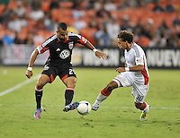 D.C. United forward Santos Maicon (29) goes against New England Revolution defender Kevin Alston (30) D.C. United defeated The New England Revolution 2-1 at RFK Stadium, Saturday September 15, 2012.