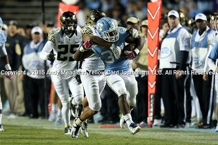 17 October 2015: UNC's Elijah Wood (34) is tackled by Wake Forest's Brandon Chubb (behind). The University of North Carolina Tar Heels hosted the Wake Foresst University Demon Deacons at Kenan Memorial Stadium in Chapel Hill, North Carolina in a 2015 NCAA Division I College Football game. UNC won the game 50-14.