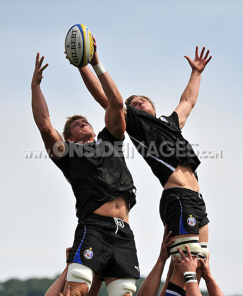 Stuart Hooper and Will Skuse compete for the ball at a lineout during the pre-match warm-up. Pre-season friendly match, between Bath Rugby and London Welsh on August 11, 2012 at the Recreation Ground in Bath, England. Photo by: Patrick Khachfe / Onside Images
