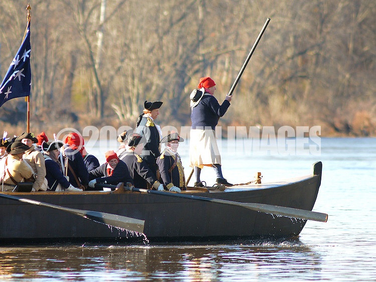 WASHINGTON CROSSING, PA - DECEMBER 7:  Re-enactors, led by George Washington, portrayed by John Godzieba (3rd from right) row a boat during a dress rehearsal for the crossing of the Delaware River at Washington Crossing State Park December 7, 2014 in Washington Crossing, Pennsylvania.  The dress rehearsal is held annually, about two weeks before the Christmas Day reenactment. (Photo by William Thomas Cain/Cain Images)