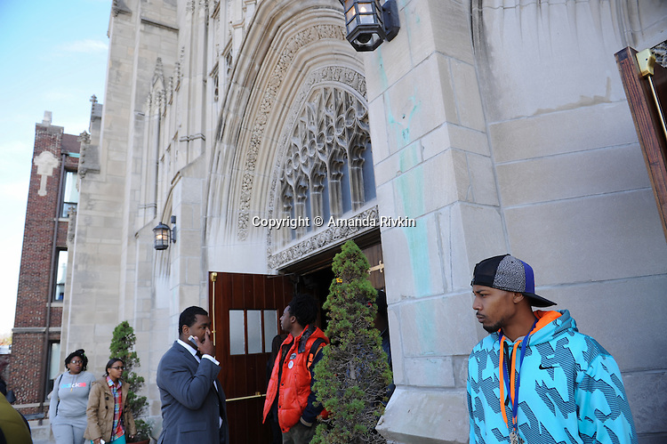 Mourners enter St. Sabina's for the funeral of Tyshawn Lee, 9, who was shot multiple times while playing basketball in an alley on November 2, 2015, in Chicago, Illinois on November 10, 2015. Police allege the killing was a retaliatory gang hit which would mark a new turn in Chicago's gang wars.