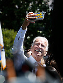 United States Vice President Joe Biden takes a selfie with some people in the public at the end of the Wounded Warrior Ride at the White House, in Washington, DC, April 14, 2016.  The event helps raise awareness to the public about severely injured veterans and provides rehabilitation opportunities. <br /> Credit: Aude Guerrucci / Pool via CNP