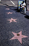 Hollywood Blvd. with stars and map seller