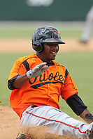 Baltimore Orioles second baseman Mychal Givens #16 slides into third during an Instructional League game against the Boston Red Sox at Buck O'Neil Complex on October 6, 2011 in Sarasota, Florida.  (Mike Janes/Four Seam Images)