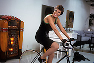 New York, March, 1987. American actress Raquel Welch working out at home.