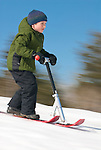 A boy rides a snow scooter in Jackson, Wyoming.