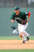First baseman Sam Travis (28) of the Greenville Drive tracks a ground ball in a game against the Rome Braves on Sunday, August 3, 2014, at Fluor Field at the West End in Greenville, South Carolina. Travis is a second-round pick of the Boston Red Sox in the 2014 First-Year Player Draft out of Indiana University. Rome won, 4-2. (Tom Priddy/Four Seam Images)
