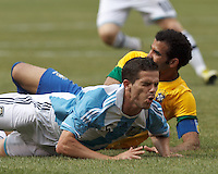 Argentina midfielder Fernando Gago (5) goes down after ankle gets hit. In an international friendly (Clash of Titans), Argentina defeated Brazil, 4-3, at MetLife Stadium on June 9, 2012.