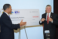 "September 13, 2011 (Prince George's County, MD)   Maryland Lt. Governor Anthony G. Brown (left)  and William ""Bill"" Hanbury, Pres. and CEO, United Way, NCA (right) presented a ceremonial check for $100,000 to community partners who will participate in the one-year pilot program, ""Way to P.E.A.C.E."", (Prevention, Education, Awareness, Connection and Empowerment), in two Prince George's middle schools this fall. An initial $50,000 state grant from the Governor's Office of Crime Control and Prevention (GOCCP) is being matched with $50,000 from the United Way NCA to support the program.  (Photo: Don Baxter/Media Images International)"