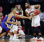 SIOUX FALLS, SD: MARCH 6: Carlton Hurst #2 of South Dakota shields the ball from South Dakota State defender Skyler Flatten #1 during the Summit League Basketball Championship on March 6, 2017 at the Denny Sanford Premier Center in Sioux Falls, SD. (Photo by Dick Carlson/Inertia)