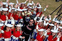 Apr 22, 2014; Kilgore, TX, USA; NHRA top fuel dragster driver Steve Torrence (center) poses for a photo with the Kilgore College Rangerettes at the Torrence estate. Mandatory Credit: Mark J. Rebilas-USA TODAY Sports