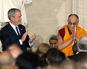 Washington, DC - October 17, 2007 -- United States President George W. Bush applauds The 14th Dalai Lama, Tenzin Gyatso, who was at The Capitol in Washington, D.C., to accept the Congressional Gold Medal, the nation's highest and most distinguished civilian award, on Wednesday, October 17, 2007. .Credit: Ron Sachs/CNP