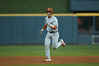 DJ Petrinsky (6) of the Texas Longhorns celebrates as he rounds the bases after hitting a home run against the LSU Tigers in game three of the 2020 Shriners Hospitals for Children College Classic at Minute Maid Park on February 28, 2020 in Houston, Texas. The Tigers defeated the Longhorns 4-3. (Brian Westerholt/Four Seam Images)