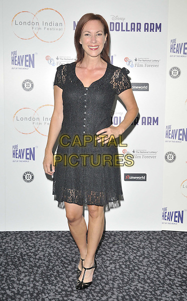 LONDON, ENGLAND - JULY 14: Tanya Franks attends the London Indian Film Festival &quot;Million Dollar Arm&quot; UK film premiere, Cineworld Shaftesbury Avenue cinema, Coventry St., on Monday July 14, 2014 in London, England, UK. <br /> CAP/CAN<br /> &copy;Can Nguyen/Capital Pictures