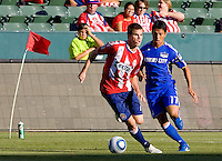 CD Chivas USA forward Justin Braun moves around Kansas City Wizards defender Roger Espinnoza. The Kansas City Wizards defeated CD Chivas USA 2-0 at Home Depot Center stadium in Carson, California on Sunday September 19, 2010.
