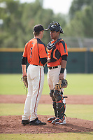 San Francisco Giants catcher Ricardo Genoves (15) talks to pitcher Tyler Schimpf (1) during an Instructional League game against the Kansas City Royals at the Giants Training Complex on October 17, 2017 in Scottsdale, Arizona. (Zachary Lucy/Four Seam Images)