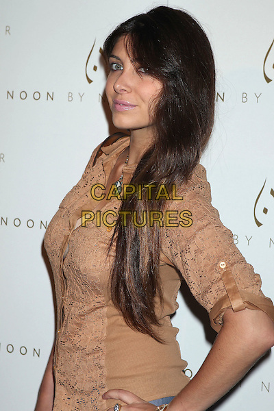 Brittny Gastineau.'Noon by Noor' Launch Event held at the Sunset Tower Hotel, West Hollywood, California, USA..July 20th, 2011.half length beige shirt perforated eye eyes necklace side.CAP/ADM/RE.©Russ Elliot/AdMedia/Capital Pictures.
