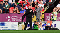 Lincoln City's first team coach Jamie McCombe speaks to Fourth official Robert Atkin<br /> <br /> Photographer Chris Vaughan/CameraSport<br /> <br /> The EFL Sky Bet League One - Lincoln City v Bristol Rovers - Saturday 14th September 2019 - Sincil Bank - Lincoln<br /> <br /> World Copyright © 2019 CameraSport. All rights reserved. 43 Linden Ave. Countesthorpe. Leicester. England. LE8 5PG - Tel: +44 (0) 116 277 4147 - admin@camerasport.com - www.camerasport.com