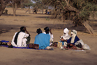 Akadaney, Niger, Africa - Fulani Men at Geerewol, Talking Under Acacia Trees.  The Geerewol, at the end of the rainy season, is a time for arranging marriages, renewing family ties, catching up on news, political consultations, and the renewing of bonds between disparate clans of the nomadic Fulani.
