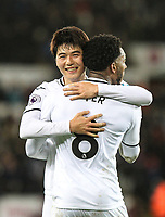 Ki Sung-Yueng of Swansea City celebrates with Leroy Fer of Swansea City during the Premier League match between Swansea City and Liverpool at the Liberty Stadium, Swansea, Wales on 22 January 2018. Photo by Mark Hawkins / PRiME Media Images.