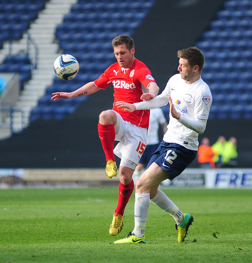 Crawley Town's Dannie Bulman shields the ball from Preston North End's Paul Gallagher <br /> <br /> Photo by Chris Vaughan/CameraSport<br /> <br /> Football - The Football League Sky Bet League One - Preston North End v Crawley Town - Saturday 29th March 2014 - Deepdale - Preston<br /> <br /> &copy; CameraSport - 43 Linden Ave. Countesthorpe. Leicester. England. LE8 5PG - Tel: +44 (0) 116 277 4147 - admin@camerasport.com - www.camerasport.com