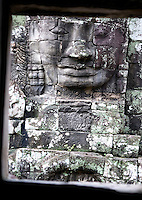 A giant face smiles in Bayon temple, in Angkor, Cambodia, on October 9, 2009. The Bayon temple was built in the late 12th century or early 13th century as the official state temple of the Mahayana Buddhist King Jayavarman VII. Angkor used to be the seat of the Khmer empire, which flourished from approximately the ninth century to the thirteenth century. The ruins of Angkor temples are a UNESCO World Heritage Site. Photo by Lucas Schifres/Pictobank.