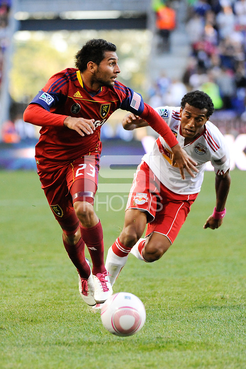 Paulo Araujo Jr. (23) of Real Salt Lake is chased by Roy Miller (7) of the New York Red Bulls. The New York Red Bulls and Real Salt Lake played to a 0-0 tie during a Major League Soccer (MLS) match at Red Bull Arena in Harrison, NJ, on October 09, 2010.