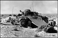 BNPS.co.uk (01202 558833)Pic:    Pen&Sword/BNPS<br /> <br /> A German Panzer tank, set up as a command post in the middle of the desert.   The tarpaulin was to protect the crew from the dust and intense heat.<br /> <br /> Fascinating rare photos of Rommel's feared Afrika Korps which terrorised the Allies in the desert have come to light in a new book.<br /> <br /> Under the direction of legendary German commander Field Marshal Erwin Rommel, who was nicknamed the Desert Fox, the corps were recognised as a superb fighting machine.<br /> <br /> They achieved their greatest triumph when they outmanoeuvred the British at the Battle of Gazala in June 1942 which led to them capturing Tobruk in Libya.<br /> <br /> But they were ultimately defeated in the iconic Battle of Alamein when they succumbed to an offensive led by Field Marshal Bernard Montgomery.