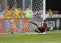 DC United goalkeeper Troy Perkins (23) dives to save a goal from a penalty kick. LA Galaxy defeated DC United 2-1 at RFK Stadium, Saturday July 18, 2010.