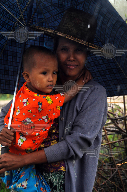 Ma Yi Yi Myint, 45, with her daughter Khin Myint Win. They lost their home when Cyclone Nargis hit Burma on 02/05/2008. Ma Au Pin village, near Pyapon.