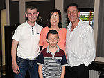 Paula Owens celebrating her 50th birthday in The Pheasant with husband Baz and sons Reece and Jay. Photo:Colin Bell/pressphotos.ie