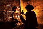 India, Rajasthan, men smoking at night