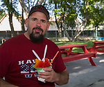 Joe Krivac enjoys a shaved ice dessert during Sizzling Saturdays Food Truck event in Sparks on Saturday , July 20, 2019.