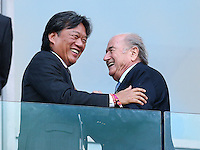 Costa Rica football president Eduardo Li Sanchez shakes hands with FIFA president Sepp Blatter before kick off
