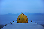 Yellow Pumpkin, a piece of art by Yayoi Kusama at dusk in Benesse Art Site. Naoshima. Setouchi Islands. Japan.<br />