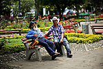 Residents talk as they rest in the town of Jardin in Antioquia August 1, 2012. Photo by Eduardo Munoz Alvarez / VIEW.