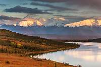 Mt Brooks and the Alaska Range bordering Wonder Lake and the autumn colored tundra, Denali National Park, Alaska.