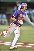 Clemson Tigers shortstop Eli White (4) runs to first base during a game against the Maine Black Bears at Doug Kingsmore Stadium on February 20, 2016 in Clemson, South Carolina. The Tigers defeated the Black Bears 9-4. (Tony Farlow/Four Seam Images)