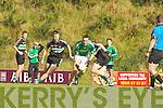 Maitiu O Suilleabhain Colaiste na Sceilige goes past Alan O'Callaghan Colaiste Chrois Ri in Killarney on Wednesday