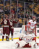 Bill Arnold (BC - 24) and Kevin Hayes (BC - 12) celebrate an Eagles' goal. - The Boston College Eagles defeated the Boston University Terriers 3-1 (EN) in their opening round game of the 2014 Beanpot on Monday, February 3, 2014, at TD Garden in Boston, Massachusetts.
